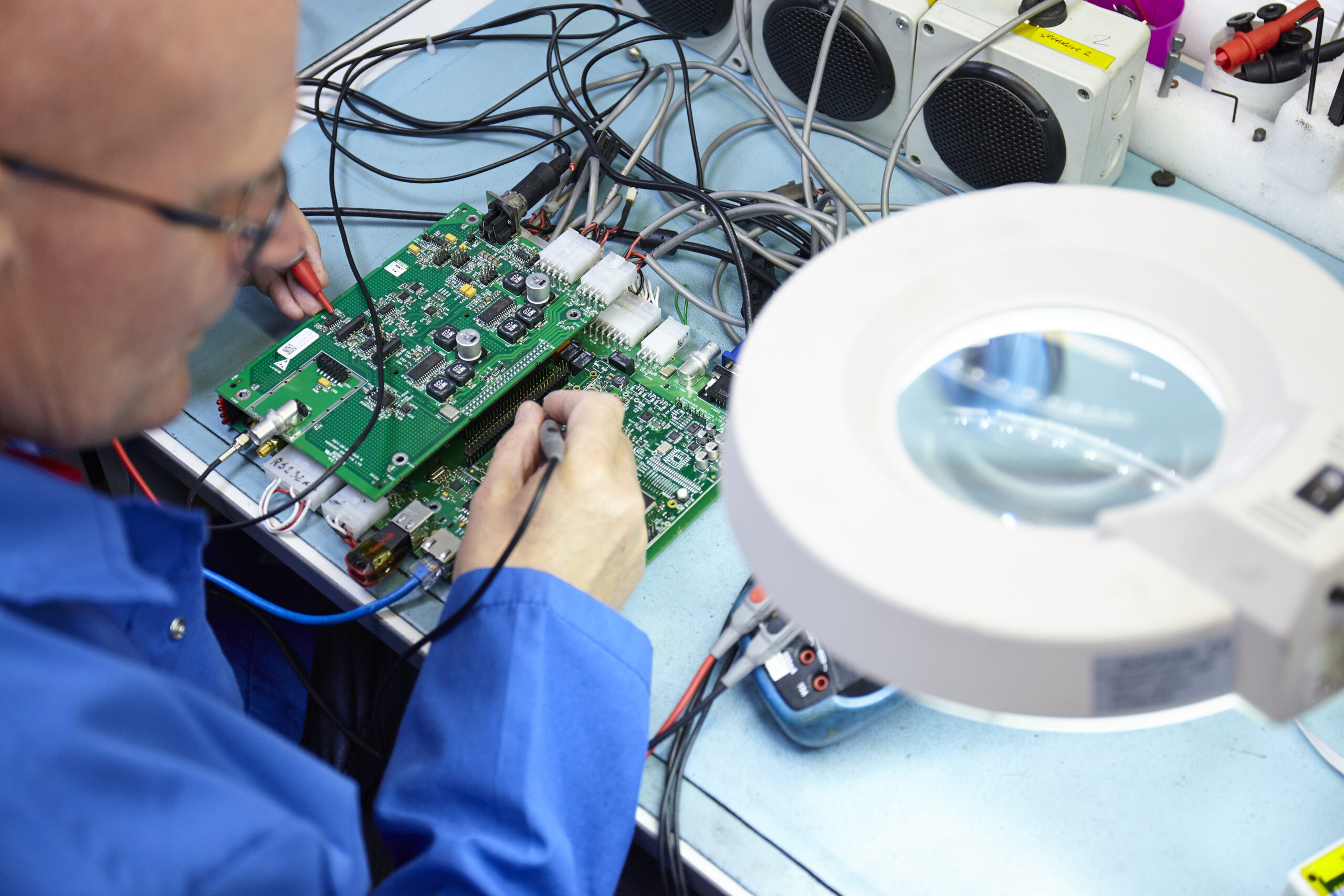 man testing printed circuit boards
